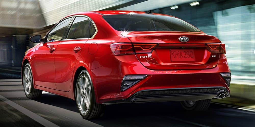 2019 red kia forte driving through tunnel