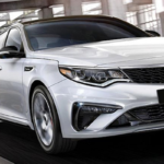 White 2020 Kia Optima S on Highway
