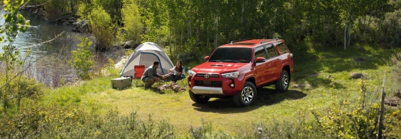 red 2020 Toyota 4Runner parked at campsite