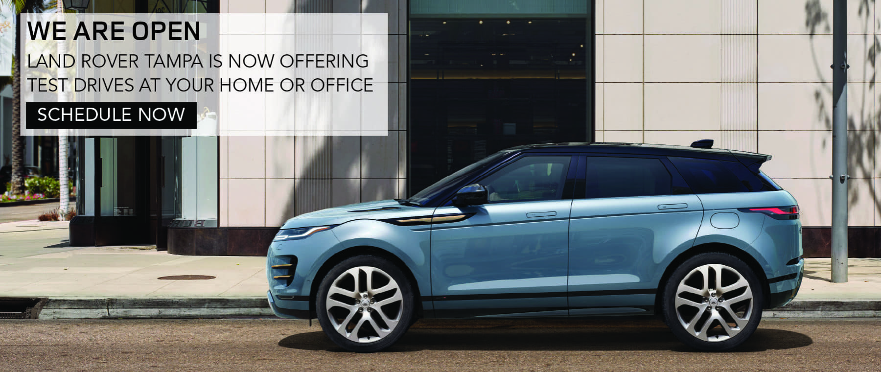 WE ARE OPEN. LAND ROVER TAMPA IS NOW OFFERING TEST DRIVES AT YOUR HOME OR OFFICE. SCHEDULE NOW. LIGHT BLUE RANGE ROVER EVOQUE DRIVING THROUGH CITY.