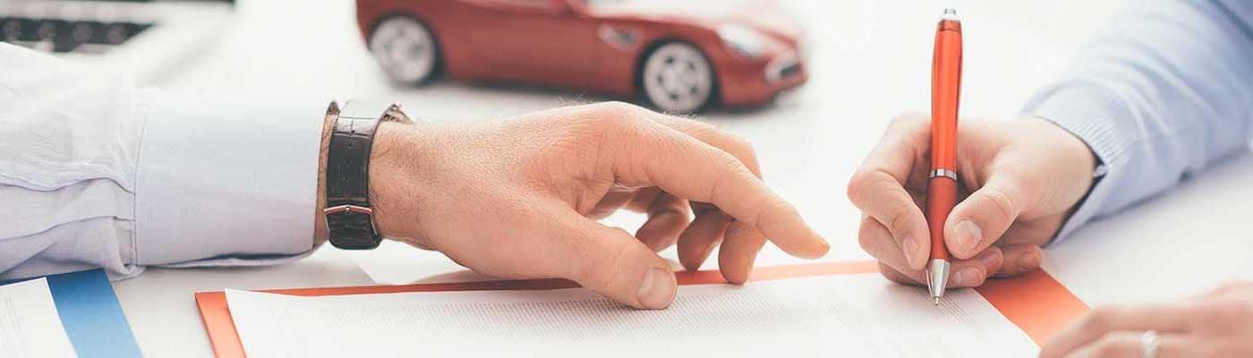 car finance paperwork at dealership