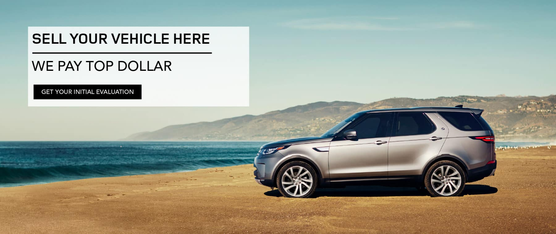SELL YOUR VEHICLE HERE. WE PAY TOP DOLLAR. GET YOUR INITIAL EVALUATION. SILVER DISCOVERY PARKED ON BEACH.