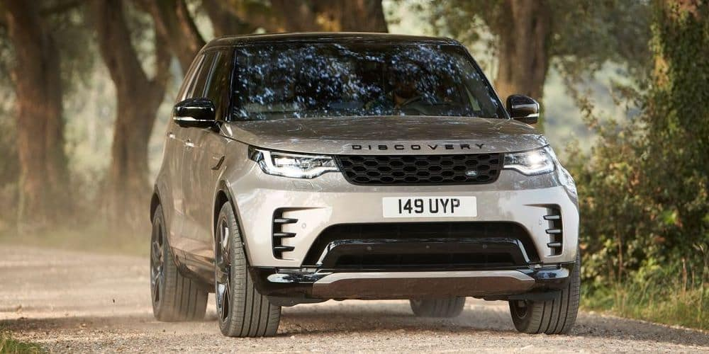 2021 Land Rover Discovery Driving through woods on gravel road