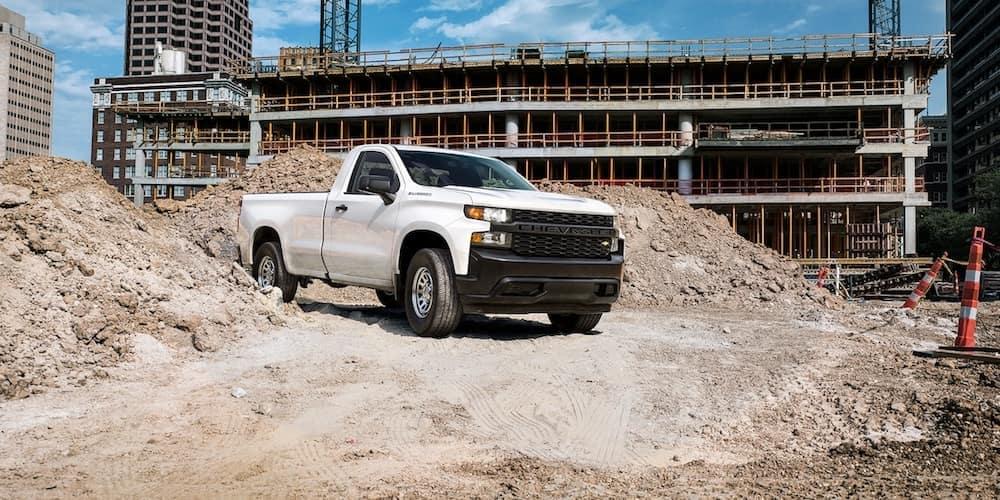 White Chevy Silverado on a job site