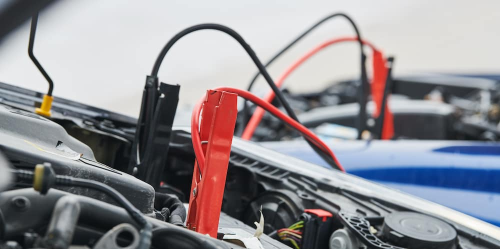 Jumper Cables Connecting 2 Batteries