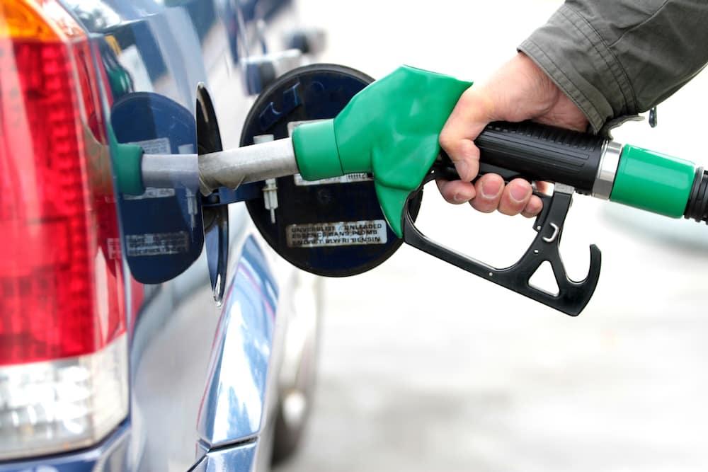 Green Gas Pump Filling Car