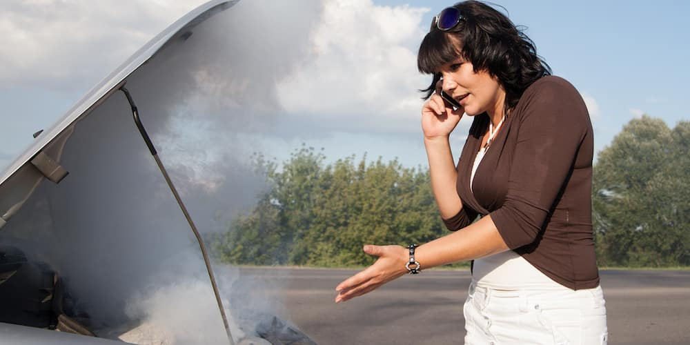 Woman Calling for Service for Overheating Car 12623306_xl-2015