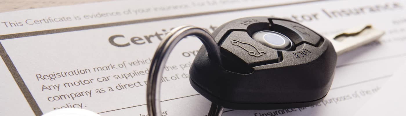 Car keys and insurance documents