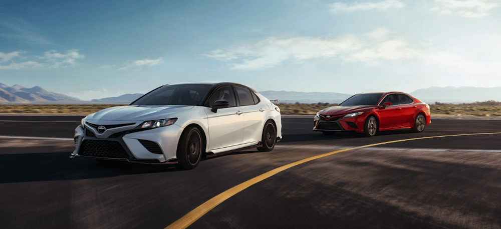 2020 Toyota Camry two cars red and white
