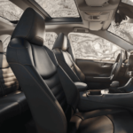 2020 Toyota RAV4 interior front and 2nd row seating with dashboard