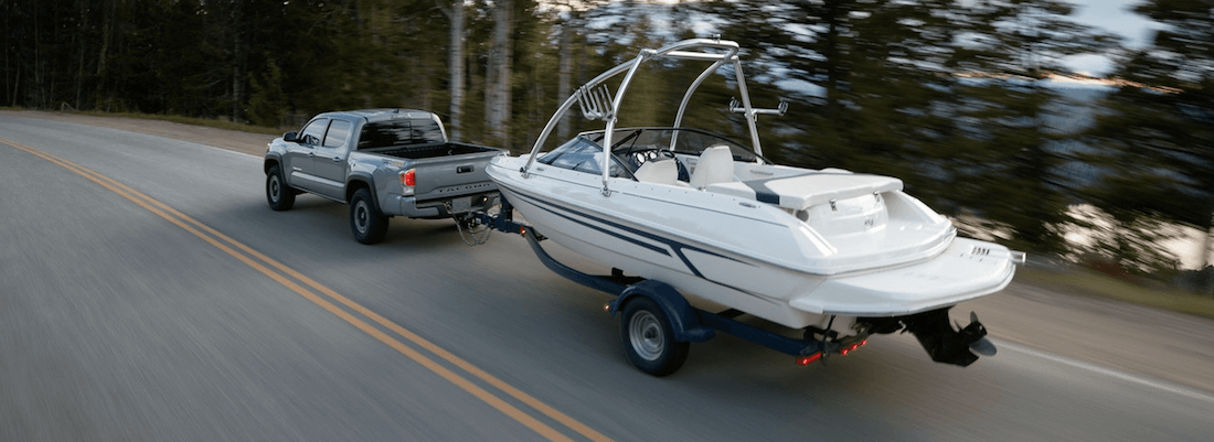 2020 Toyota Tacoma towing a boat on Dallas road