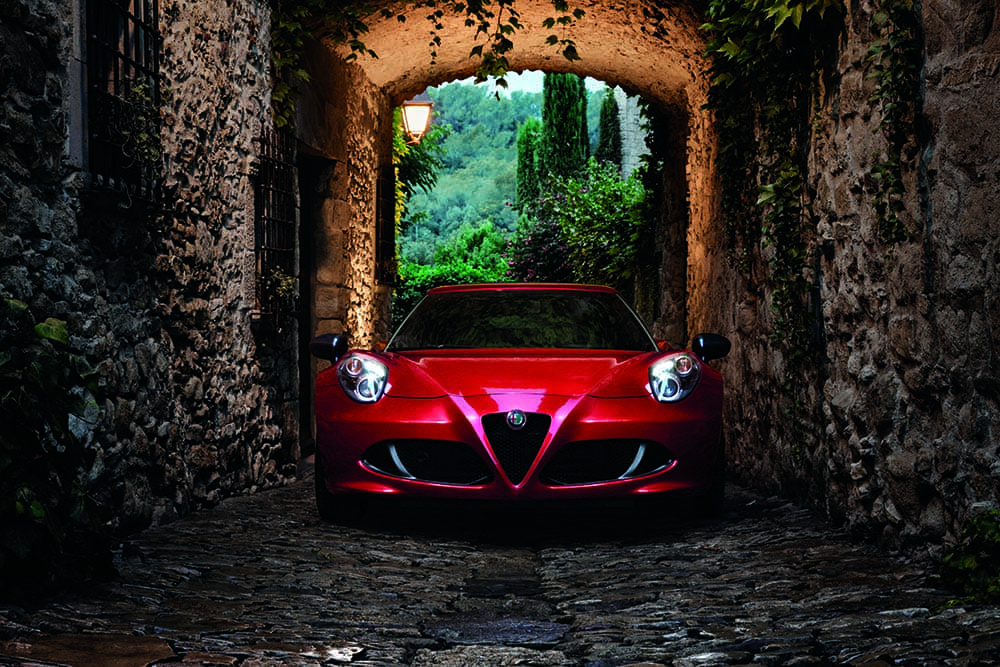 2018 Alfa Romeo 4C parked under stone building