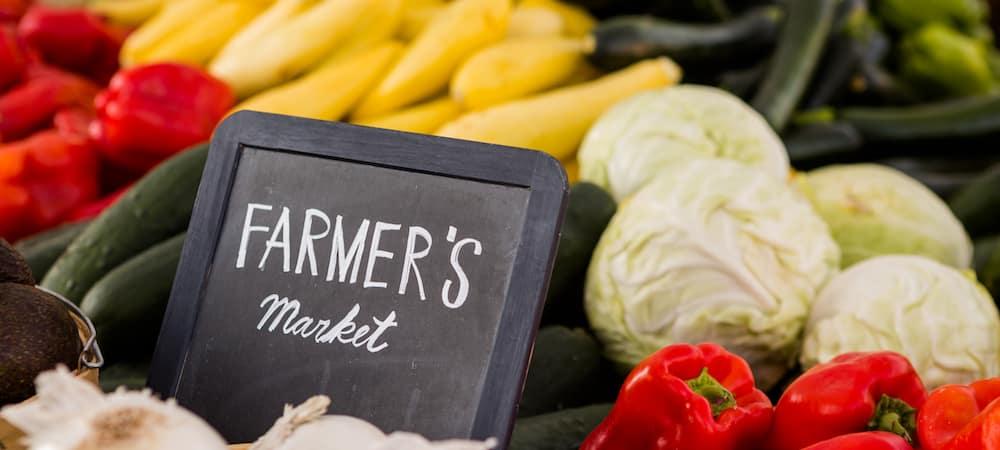 Farmer's market sign next to fresh produce