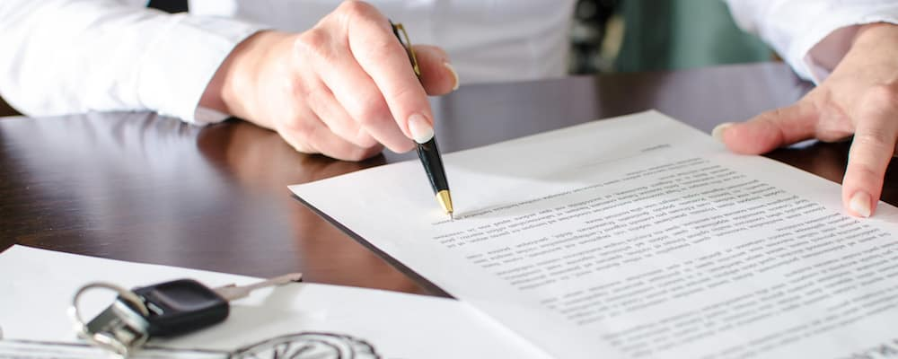 Person reading car purchase contract