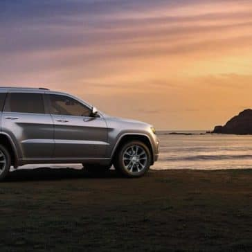 2018 Jeep Grand Cherokee on the beach at sunset
