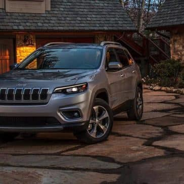 2019 Jeep Cherokee parked in front of house