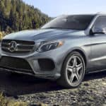 Mercedes-Benz GLE SUV near lake and forest
