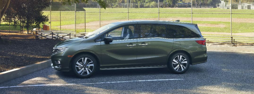 Green 2018 Honda Odyssey Parked at Baseball Diamond
