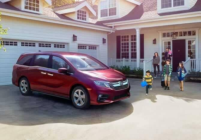 2019 Honda Odyssey parked in front of garage