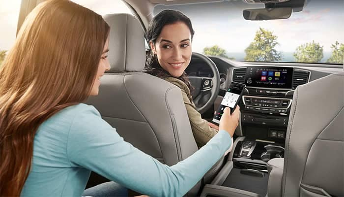 Mom and Daughter Using Technology Features in 2019 Honda Pilot