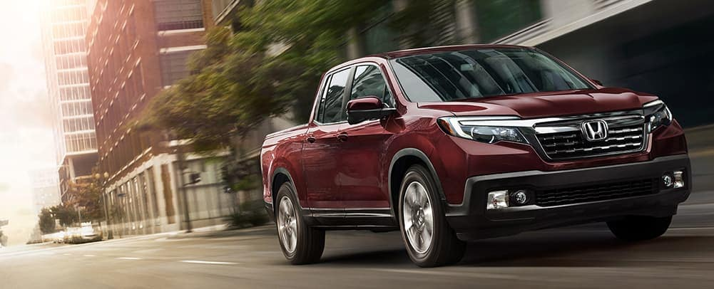 2019 Honda Ridgeline in Red on the Road