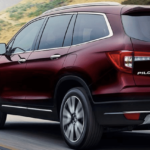 2019 Honda Pilot in Red on the Road