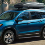 2020 Honda Pilot parked by a fishing pond