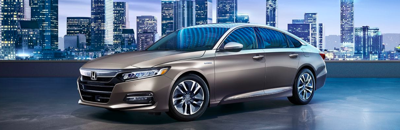 Exterior view of a 2019 Honda Accord with a city skyline in the background