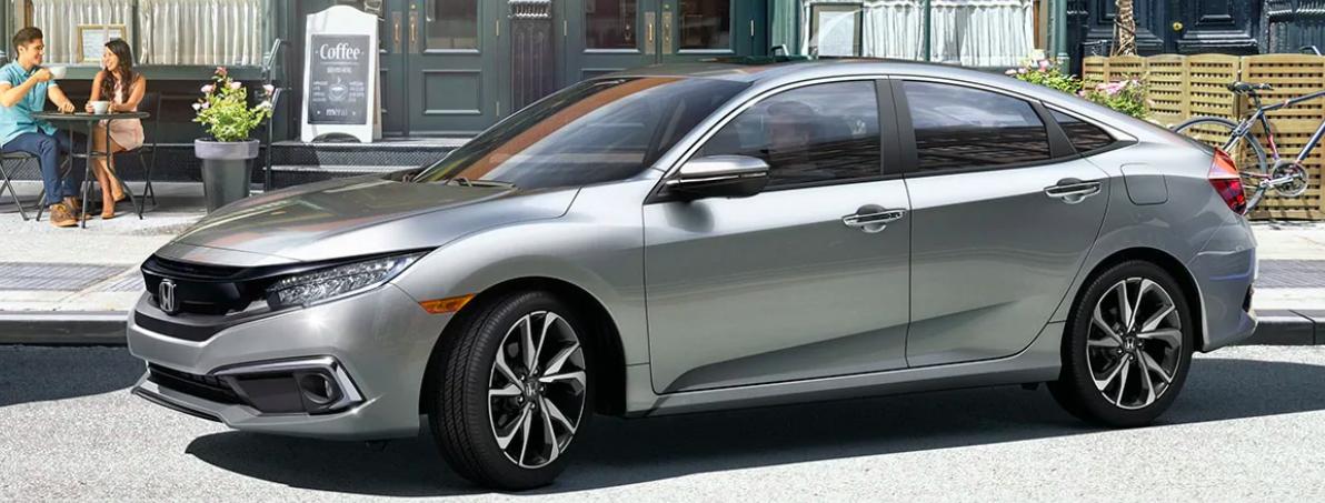 A 2020 Honda Civic parked outside a cafe