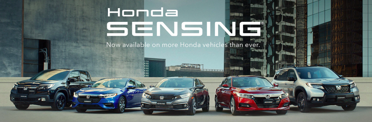 A row of parked new Honda vehicles that feature Honda Sensing