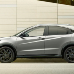 A man walking towards his 2021 Honda HR-V