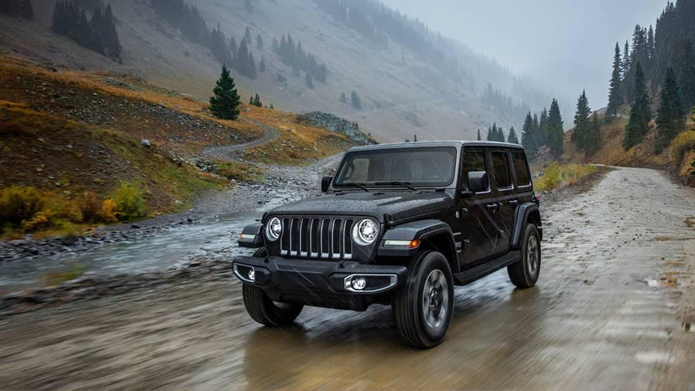 2018 Jeep Wrangler driving past mountain