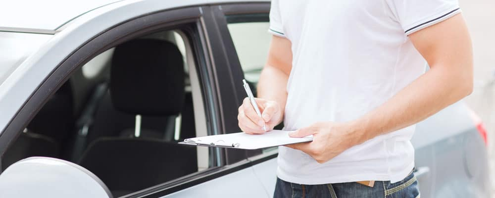 Man With Car and Documents