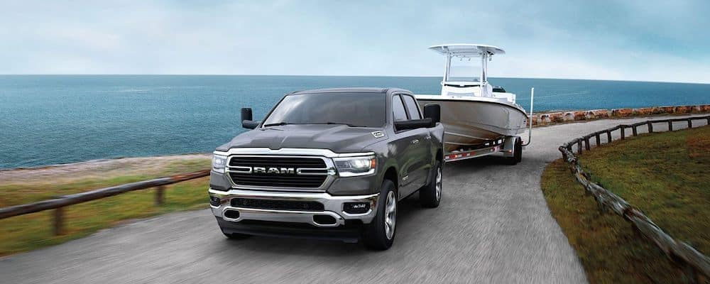 2020 Ram 1500 towing a boat by the coast