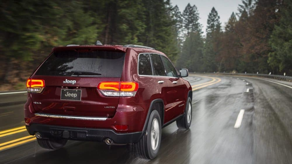 2020 Jeep Grand Cherokee on a wet road