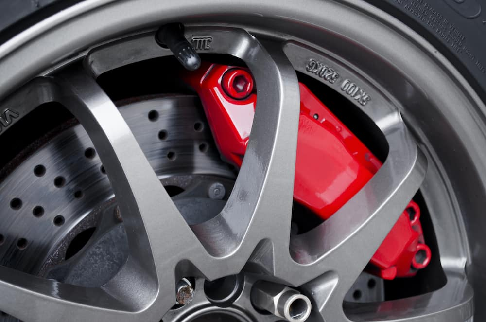 Brake pads visible with a wheel