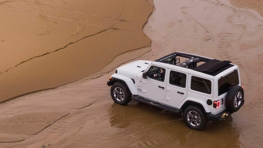 2020 Jeep Wrangler parked in the sand