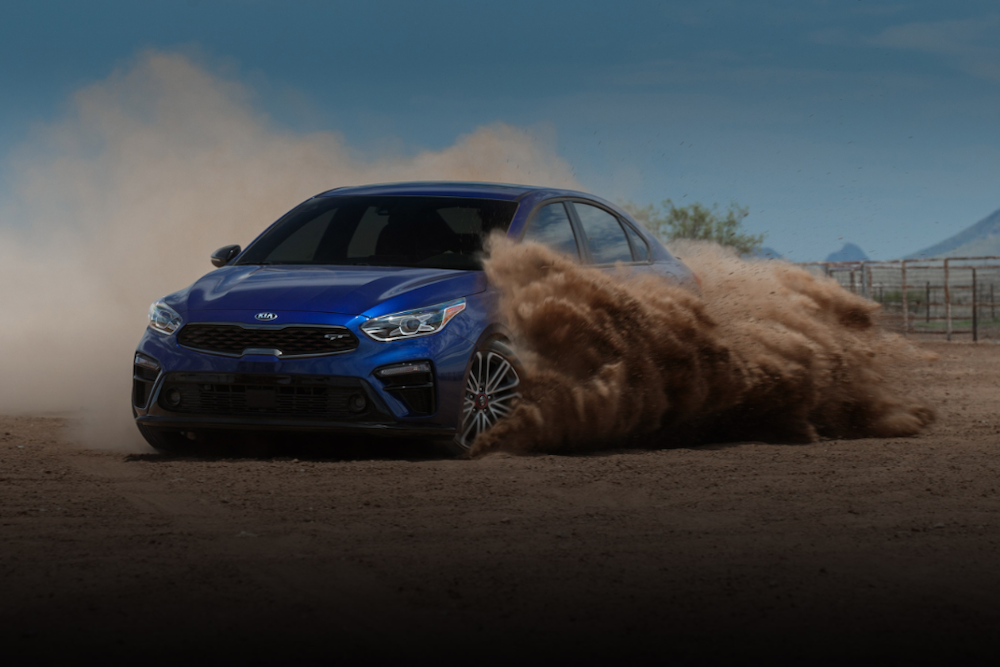 2020 Kia Forte driving in dirt