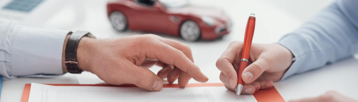 Signing a car purchase contract