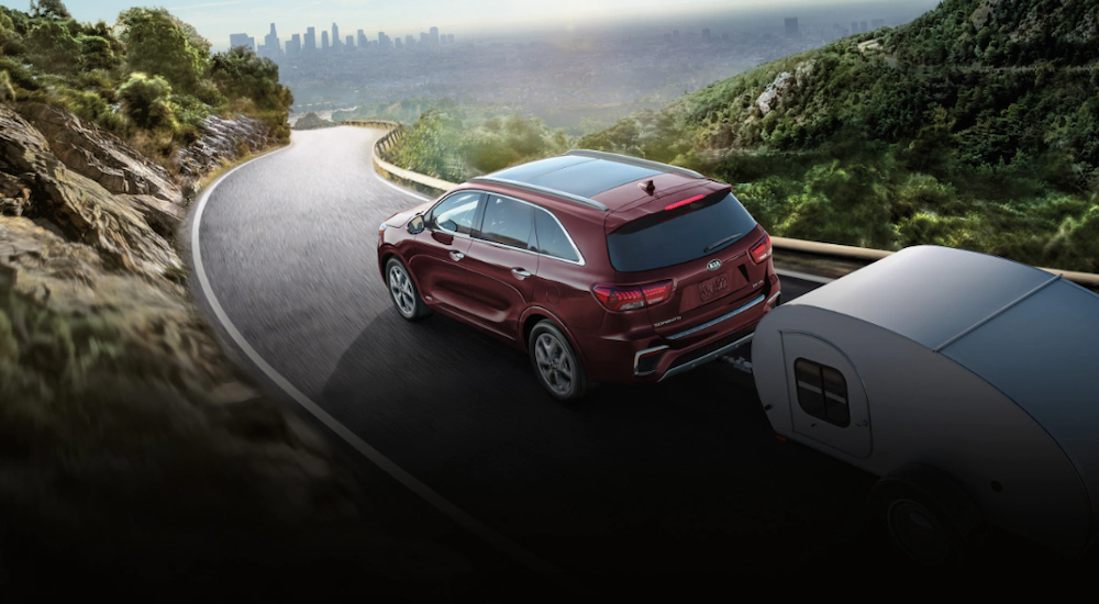 2020 Kia Sorento towing a trailer on a winding road