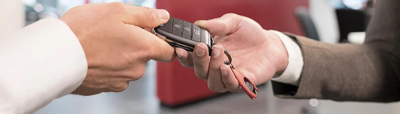 Handing off a Kia key fob