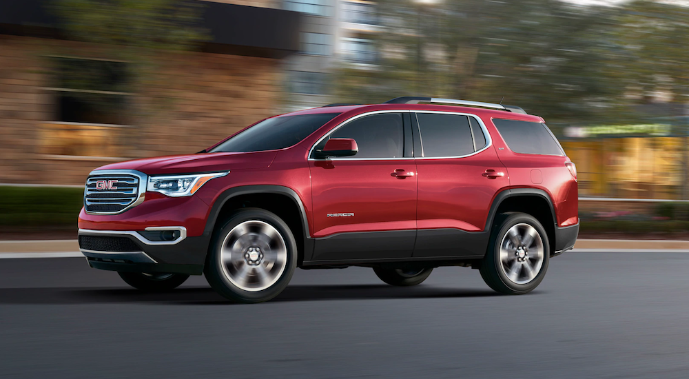 Red 2019 GMC Acadia on street