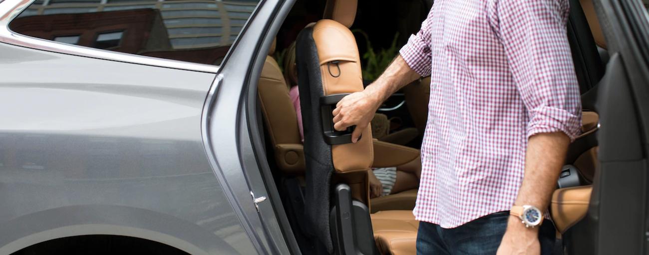 Man folding backseat of 2019 Buick Enclave