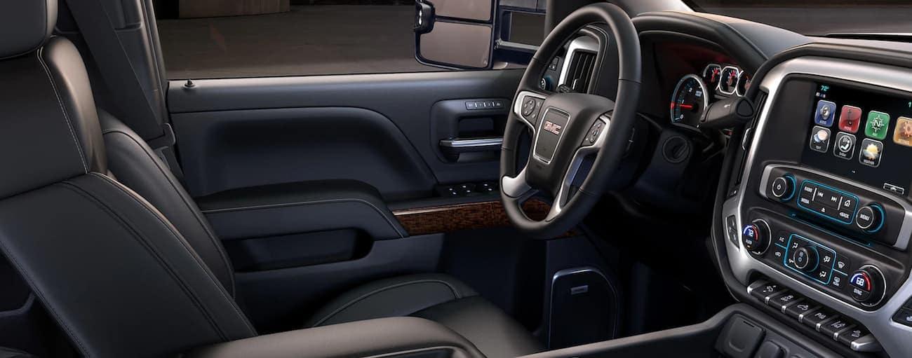 Black interior of 2019 GMC Sierra 2500HD, view from passenger seat
