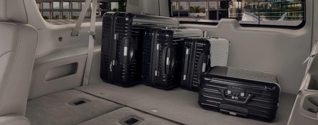 Gray interior of 2019 GMC Yukon with luggage