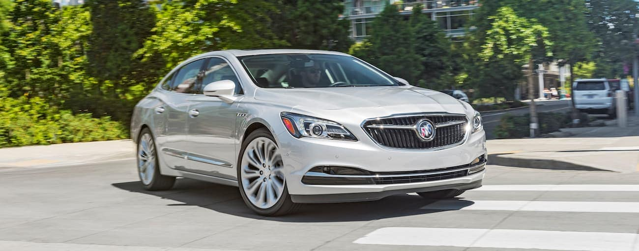A white 2019 Buick LaCrosse driving on a city street