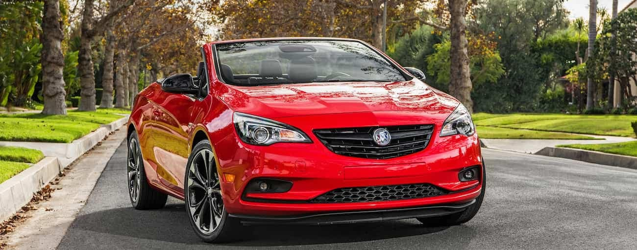 A bright red 2019 Buick Cascada, on an empty suburban street