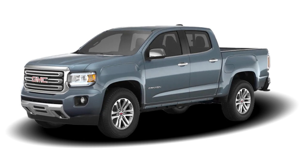 A Blue 2019 GMC Canyon on white