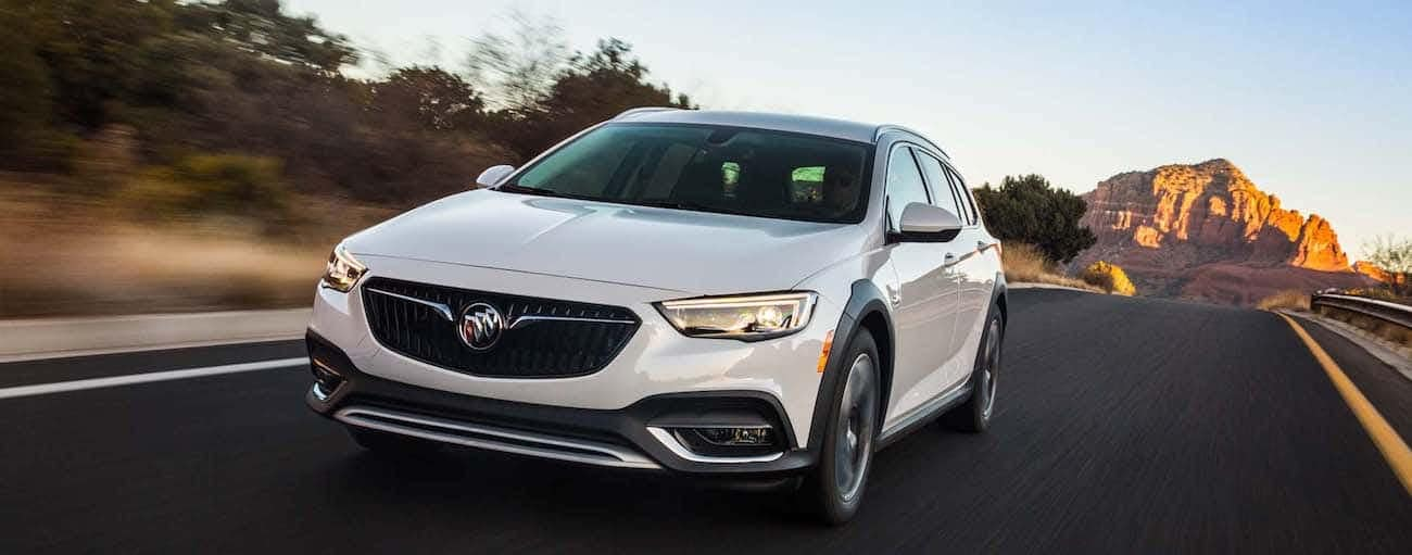 A white 2019 Buick Regal races down an empty road