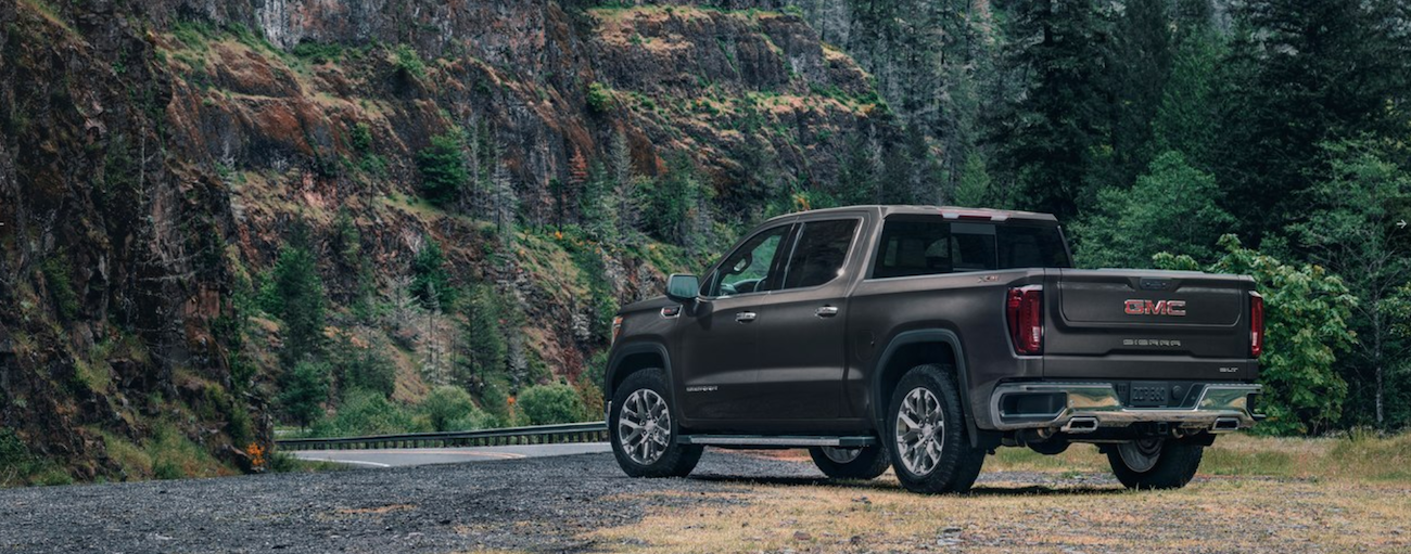 A dark gray 2019 GMC Sierra 1500 pulled off to the side of a quite country road